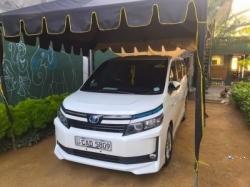 Toyota Voxy 7 Seater Hybrid 2014